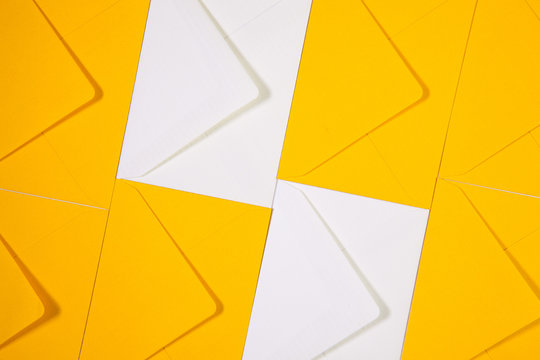 White and yellow envelopes on the  table