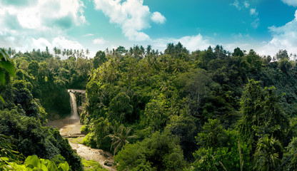Waterfall panorama in amazonian tropical rain forest with big river in the middle of jungle