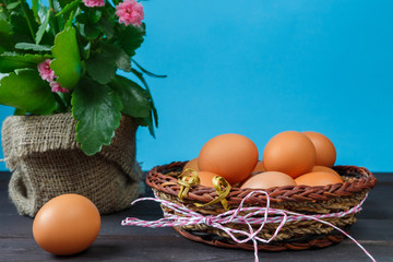 Eggs of brown chicken on blue background with copy space in rustic vintage style
