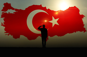 Silhouette of a man Saluting Against The Turkish Flag