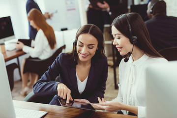 Girls-operators of the call center communicate with each other.