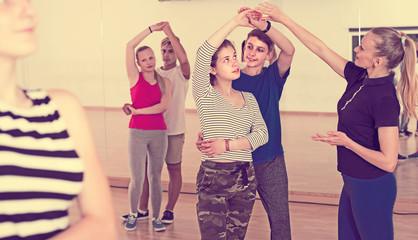 Portrait of teenagers studying of partner dance