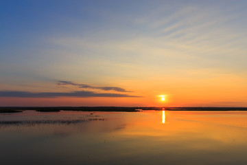 Panorama of beautiful sunset on lake.
