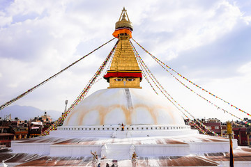 Bodhnath Stupa in Kathmandu with Buddha Eyes, Nepal. The stupa's massive mandala makes it one of the largest spherical stupas in Nepal.