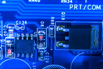electronic circuit closeup in blue glow