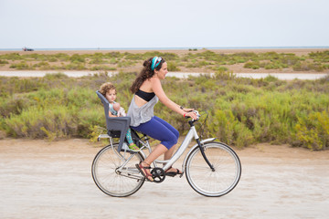 Woman riding with a toddler