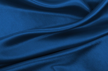 Smooth elegant blue silk or satin luxury cloth texture as abstract background. Luxurious background design