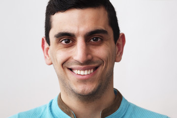 Close-up of a happy middle eastern man smiling
