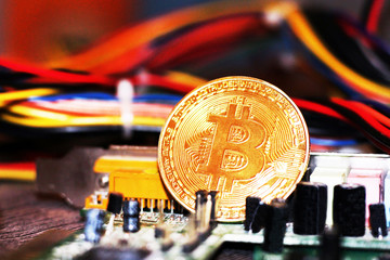 Golden Bitcoin virtual currency, colored electrical wires