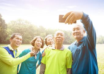 Group Of Senior Friends Taking Selfie.
