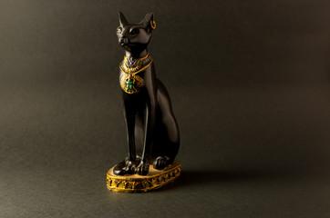 Egyptian black bastet cat figurine on black background