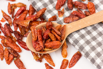 Dried red hot chili peppers on a white background.
