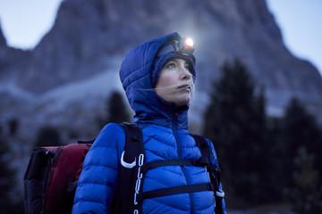 Young hiker wearing headlamp