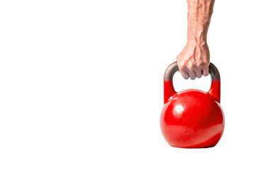 Strong muscular man hand with muscles holding red heavy kettlebell partially isolated on white background