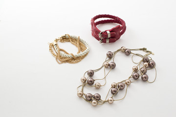 Jewelry, bracelets, beads, watches, key rings on white background