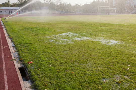 water on wet football field at thailand