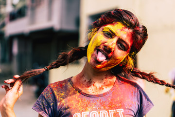 Holi festival in India : Youngster covered with holi colours