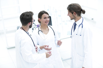 Team of different doctors having conversation