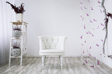 Leather white sofa on a wooden floor on a white background.