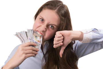 Beautiful young girl with dollars in teeth isolated on white background.