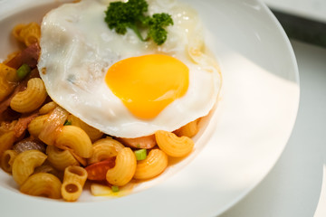 macaroni dish with fried egg