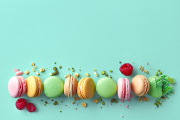 Foto op Textielframe Macarons Colorful french macarons on blue background