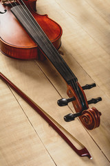 vertical photo of a violin on a table