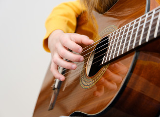 Girl playing acustic guitar