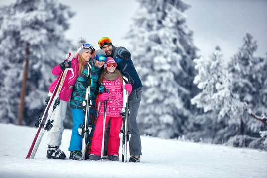 Family on ski holiday in mountains enjoying and have fun