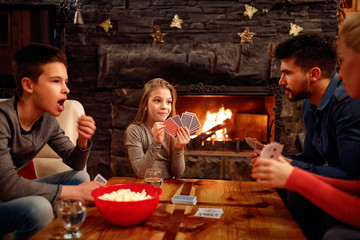 family playing cards at home