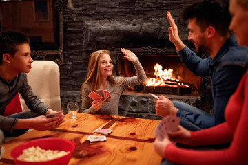 father and daughter have great time playing card