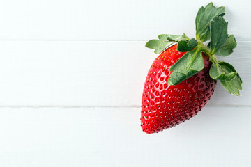 strawberry on a white wooden table