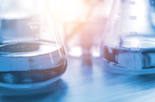 three erlenmeyer flask , Glassware on  science laboratory research and development