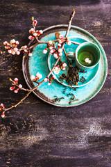 Green tea and peach blossom as a spring concept