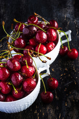 Sweet cherries on dark wooden table