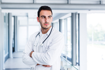 Young doctor thinks about daily tasks