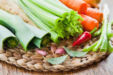 Fresh Vegetables on the board -  leeks, carrots, onion, celery, garlic, parsnip.