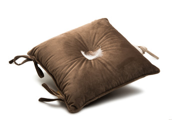 soft pillows on a chair isolated
