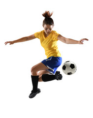 Female Soccer Player Kicking Ball