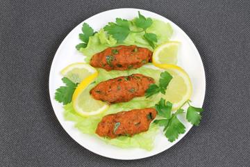 Turkish cuisine. Bulgur and red lentil, vegetarian meatball ( Mercimekli Kofte )