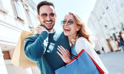 Shopping time. Young couple in shopping. Consumerism, love, dating, lifestyle concept