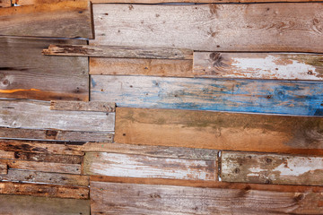Simple eco wooden desk texture. Close up of wall made of brown and blue wooden planks