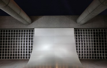 Architecture with various shapes, structures, arches, columns with grates and indirect lighting exterior facade