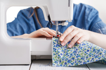 Tailor working on a sewing machine