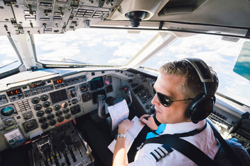 High angle view of pilot sitting in cockpit