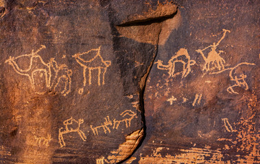 Ancient Camel Petroglyphs, Wadi Rum, Valley of the Moon, Jordan. Inhabited by humans since prehistoric times. Petroglyphs were used to guide caravans.