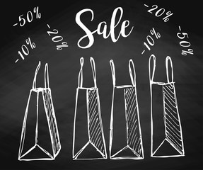 Set of shopping bags on the chalkboard. Vector illustration of a sketch style. Inscription Sale