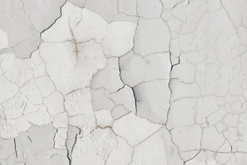 Wall background texture. white plaster in cracks.