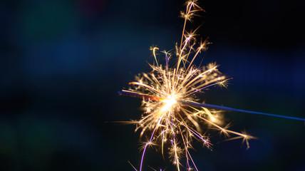 beautiful macro closeup of a sparkler at night