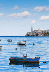 Morro Castle with Small Fishing Boats in Foreground in Havana Cuba